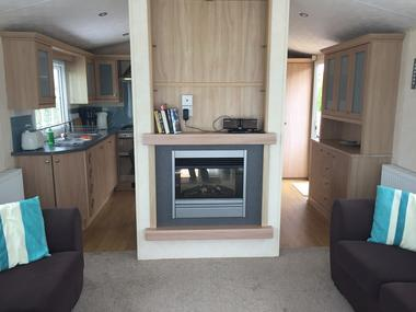 saint-maurice-etusson-camping-la-raudiere-mobile-home-cheminee.jpg