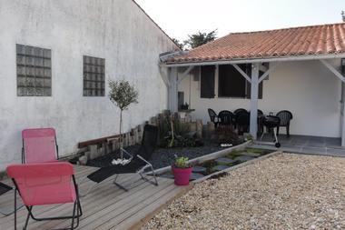 Terrasse partie détente  avec voile d ombrage