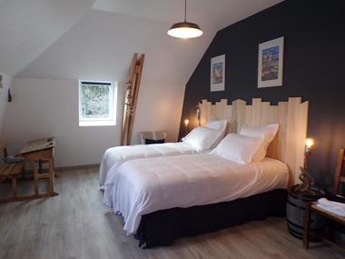 la chambre  bord de mer avec 2 lits de 90