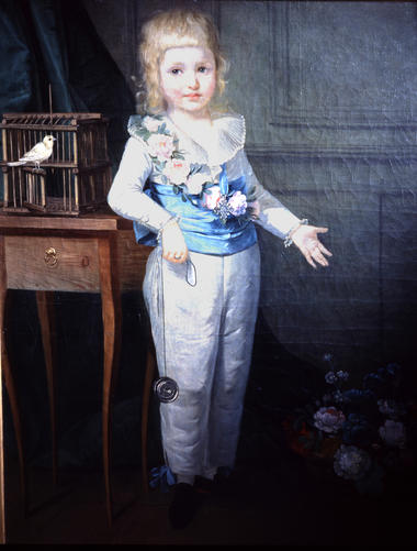 VIGEE-LE BRUN (attr.)Portrait d'un jeune garçon jouant à l'émigrette