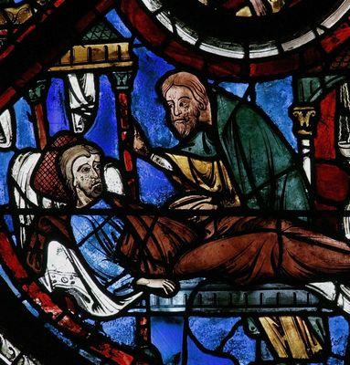 LE Samaritain se penche sur le blessé