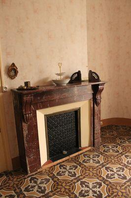 La cheminée dans la chambre