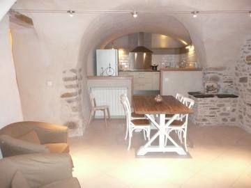 La salle à manger et la cuisine ouverte