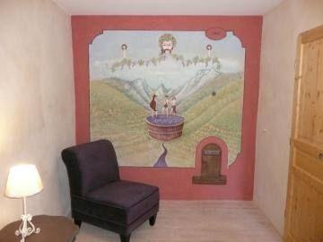 Détail de la chambre (peinture d'un artiste local)