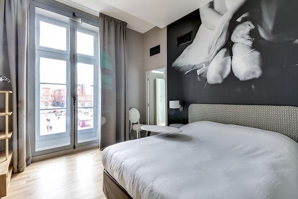 Chambre_Privilège_vue_place_du_Capitole_Hotel_du_Taur_vue_fenetre_Capitole