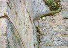 Pierre de gibet enchassée dans la tour de prison XVIe s.
